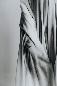 A hand that rises from a wet cloth like those old greek marble statues
